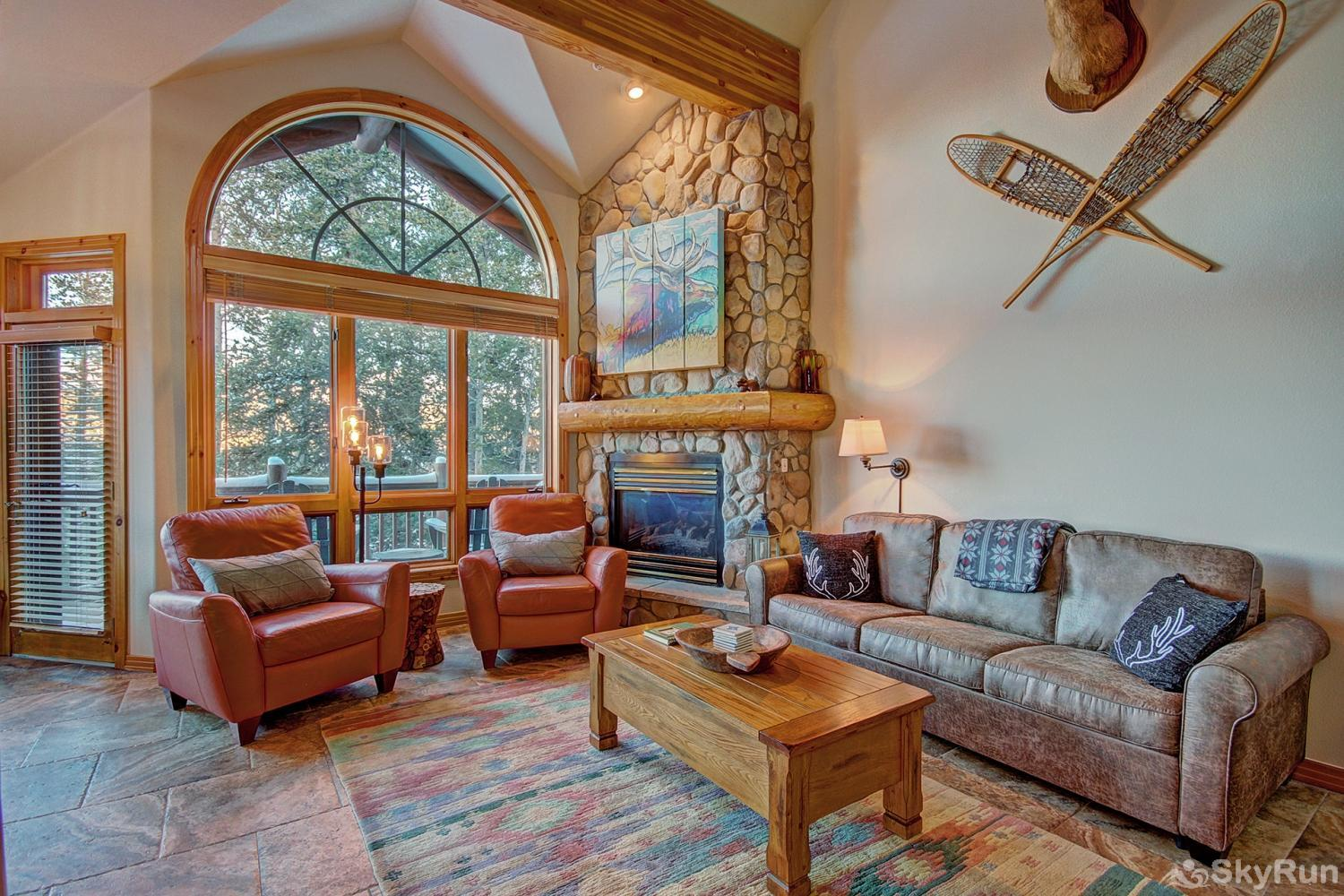 Elk Ridge Retreat Living room with lofted ceiling and floor to ceiling windows