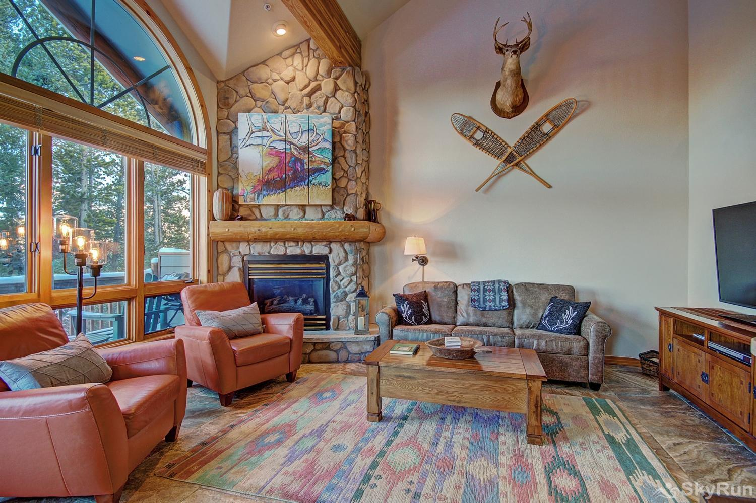 Elk Ridge Retreat Cozy living room with gas fireplace and flat screen TV