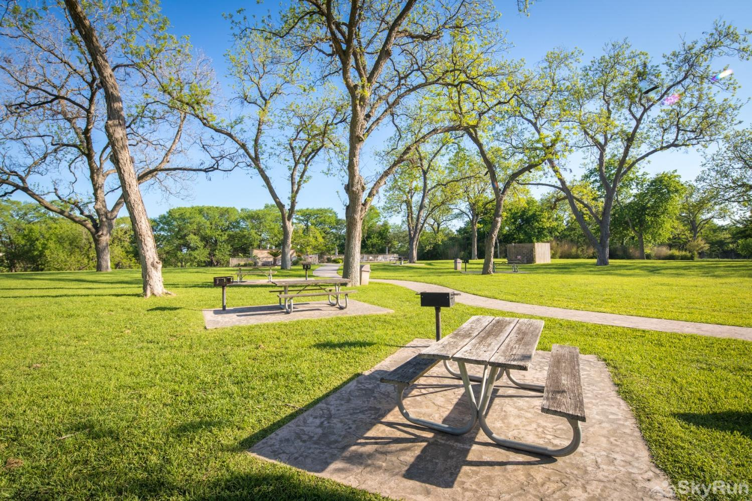 WATERWHEEL ESCAPE CONDO Many Picnic Tables under the Shady Pecan Trees