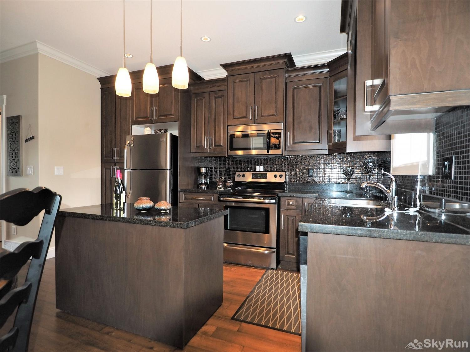 Old Summerland 3 bedroom home Granite counter tops and stainless steel appliances make this kitchen a dream to cook in.