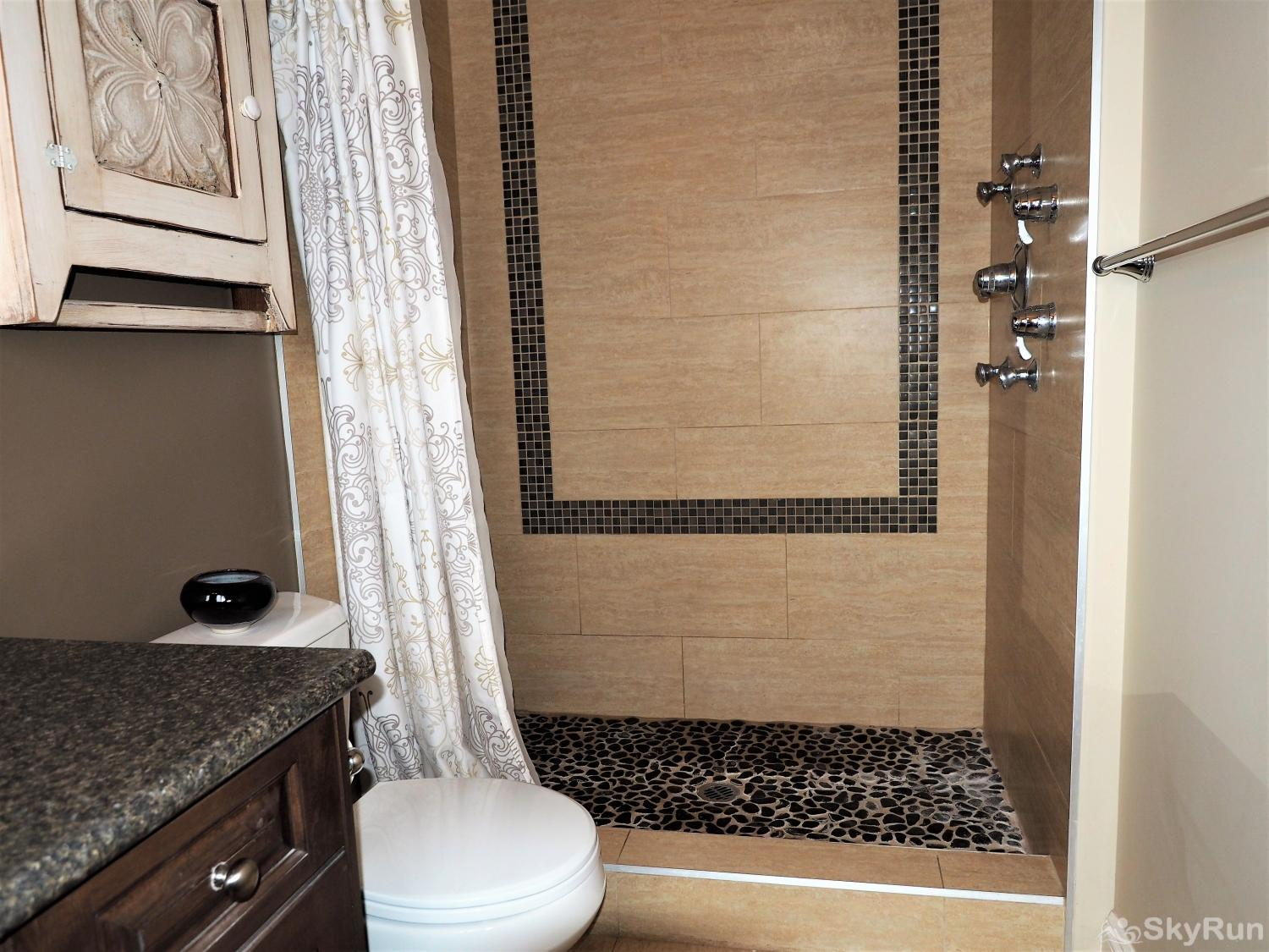 Old Summerland 3 bedroom home Huge walk in shower with multiple shower head and stones that massage your feet