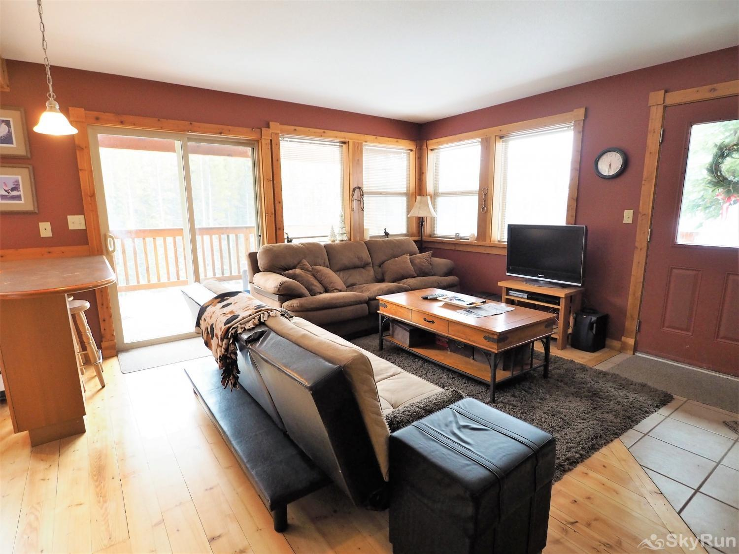 Apex Roost Guest Suite The living room doors open onto a large private patio overlooking to forests of Green Mountain