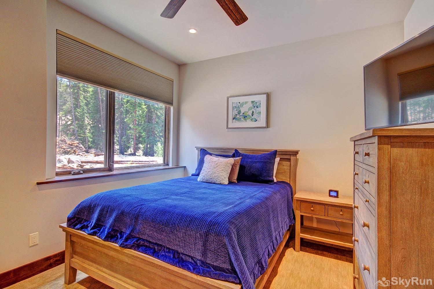 River's Edge Retreat Lower level queen bedroom with ensuite bath