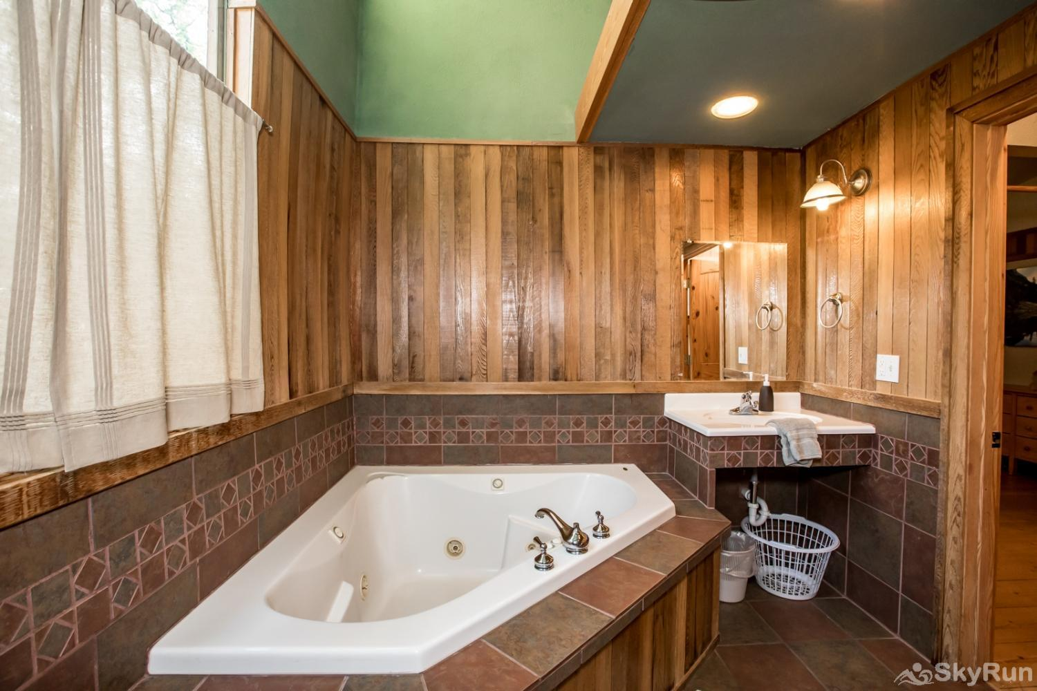 The Great House at Stillwater Mountain Lodge Soaking tub in the master bathroom