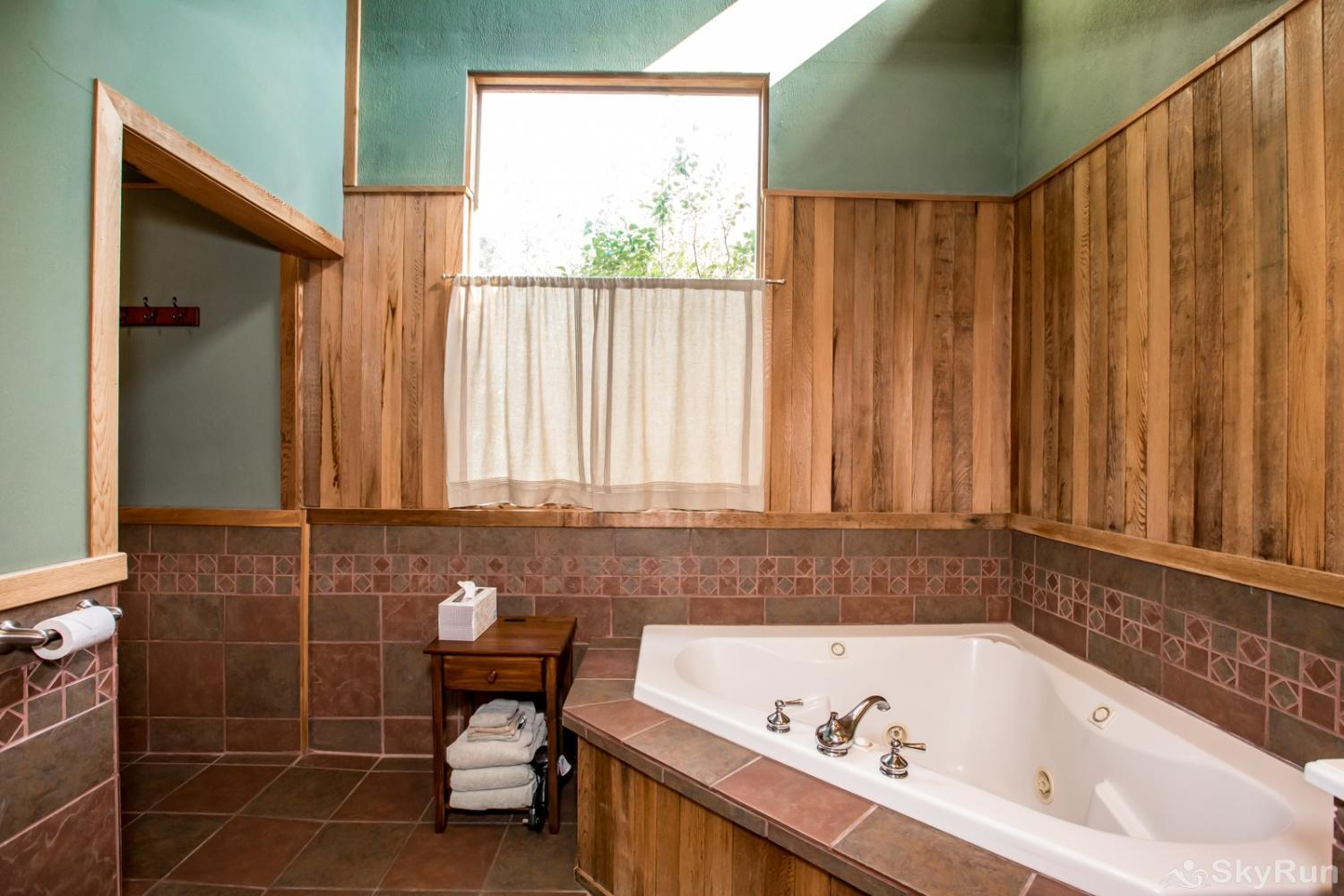 The Great House at Stillwater Mountain Lodge Master bathroom with soaking tub and shower for two