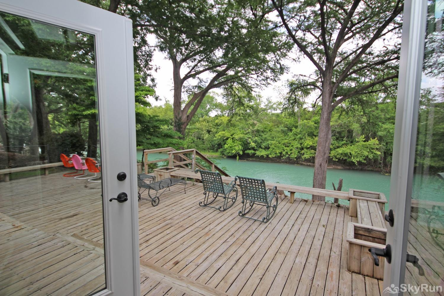 MAVERICK'S RIVER HAUS View of deck and Guadalupe River from living room