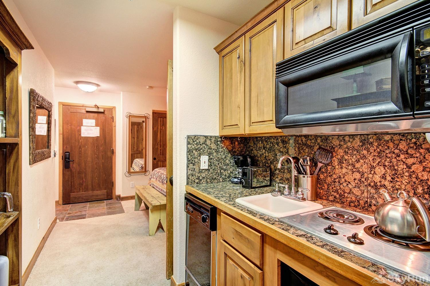 Riverbend 111 Kitchenette separates sleeping and living areas to provide spacious layout