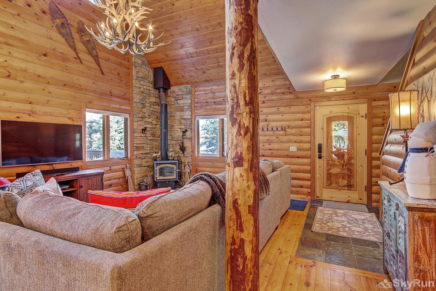The Sly Fox Hideaway Living area with wood fireplace & flat screen