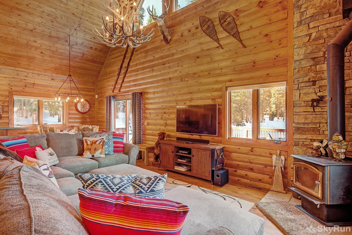 The Sly Fox Hideaway Cozy living room with wood fireplace and flat screen TV