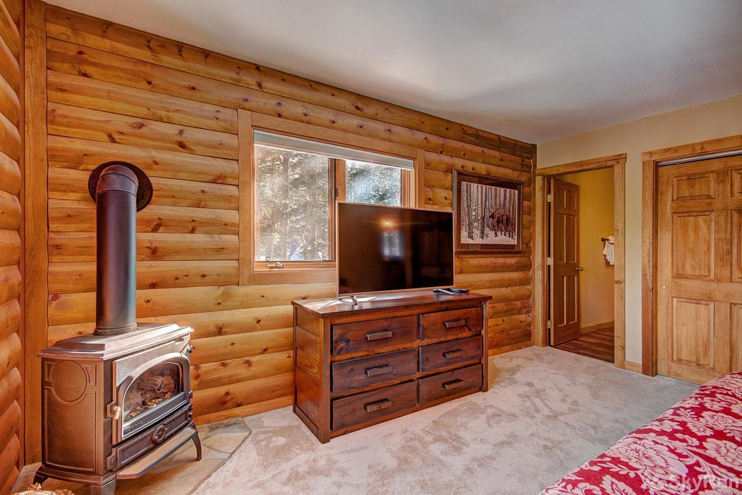 The Sly Fox Hideaway Main level king bedroom with fireplace, TV, ensuite bath