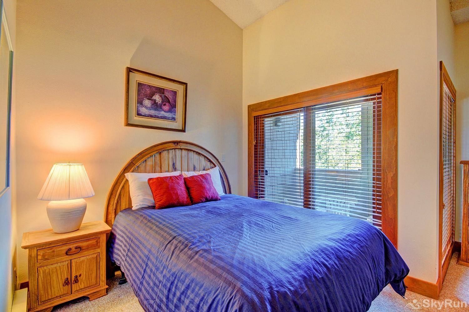 Ski Hill 8 Upper level queen bedroom with walk out private porch