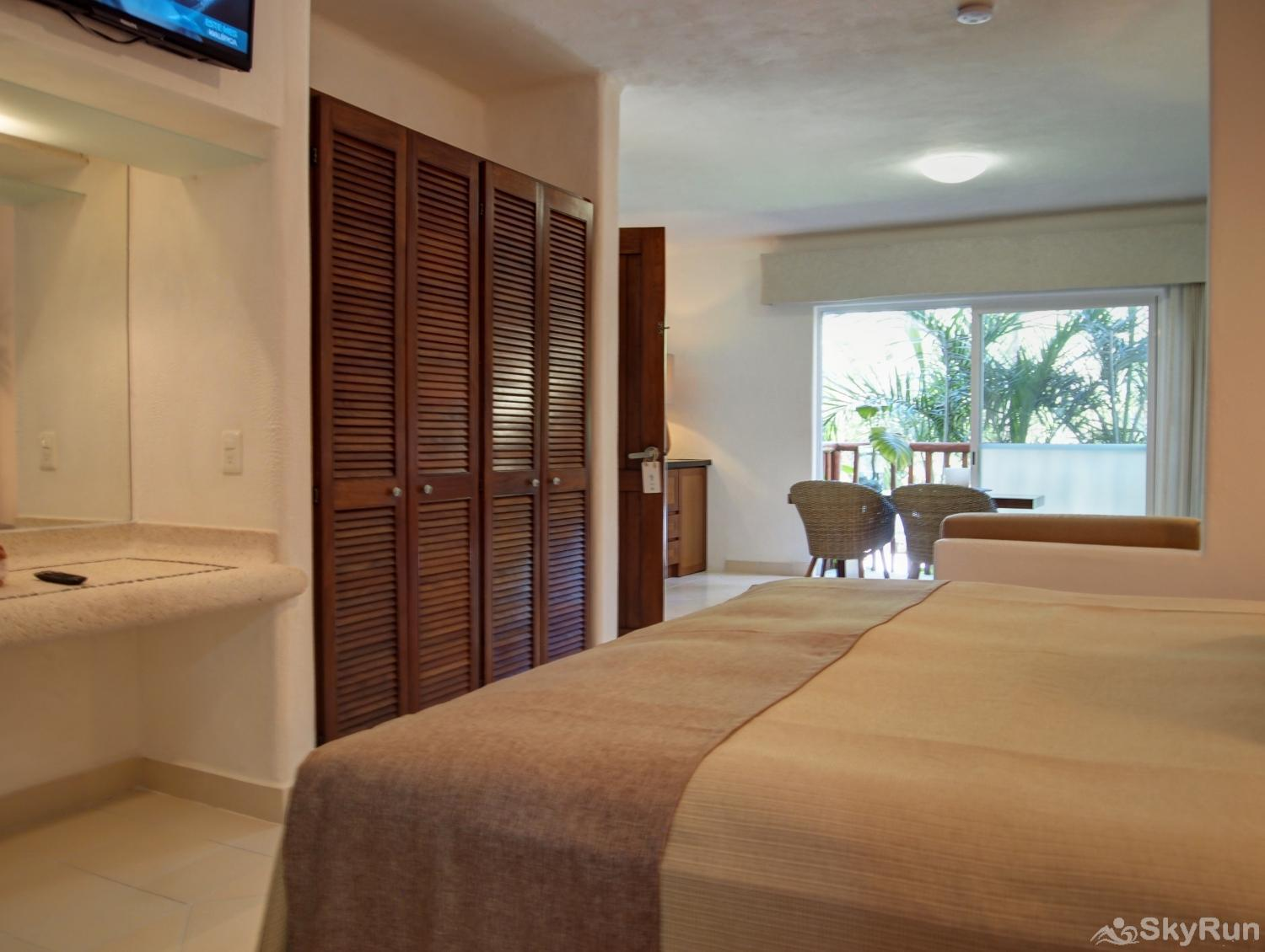 Las Villas Akumal 108  3 Bedroom Beachfront Second Floor Queen Bedroom with small living room