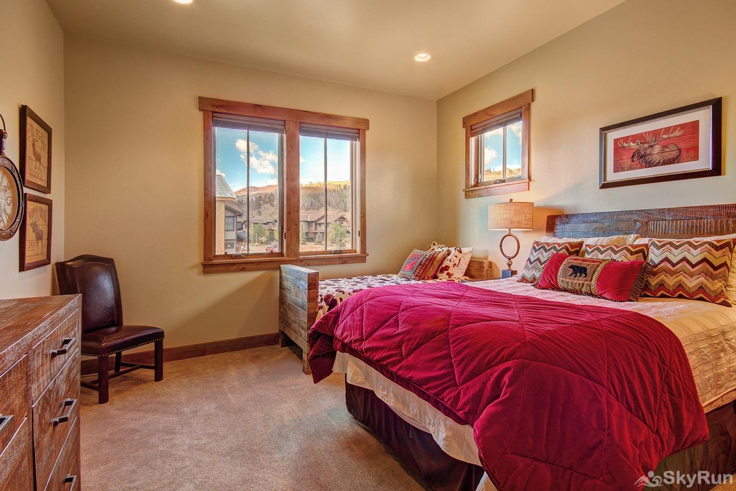 The Shores Lodge Upper level queen bedroom with twin bed, ensuite bath