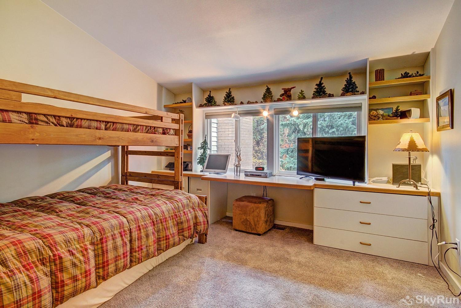 Peace In The Pines Second floor bedroom with twin over queen bunk and full trundle