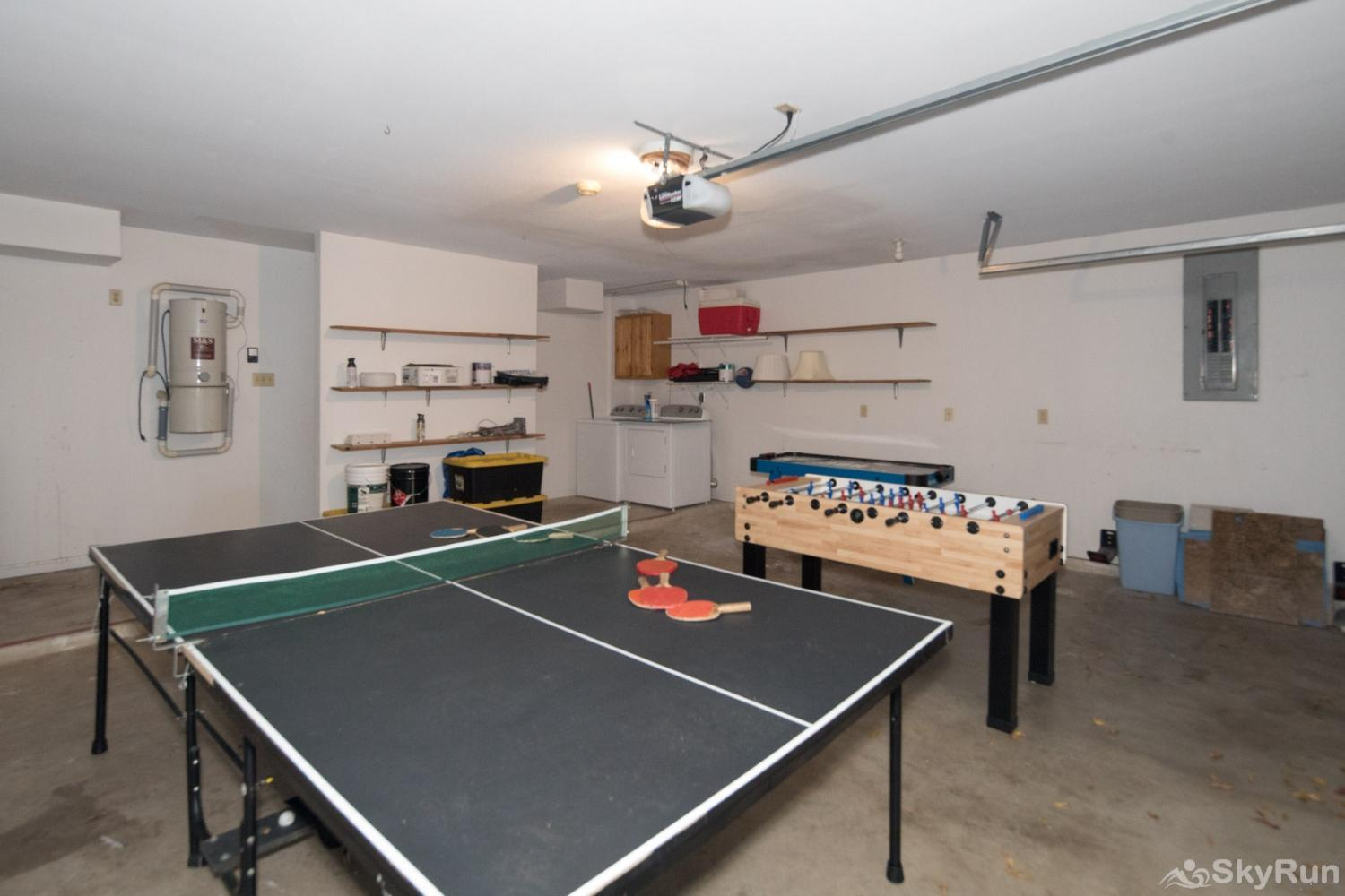 WATER'S EDGE RETREAT Garage space with foosball and ping pong tables