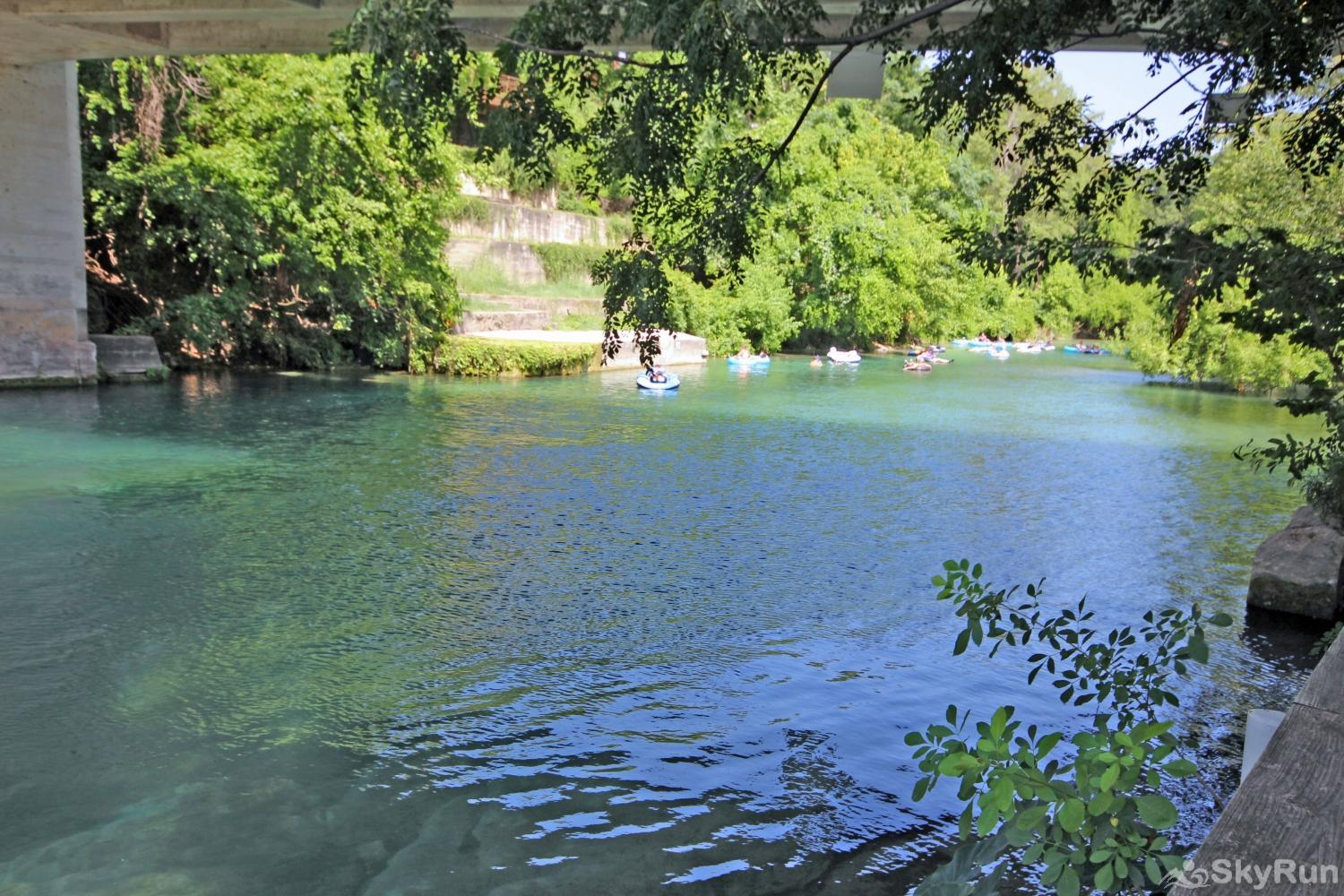 BRAUN RIO Tube through town on the beautiful Comal River