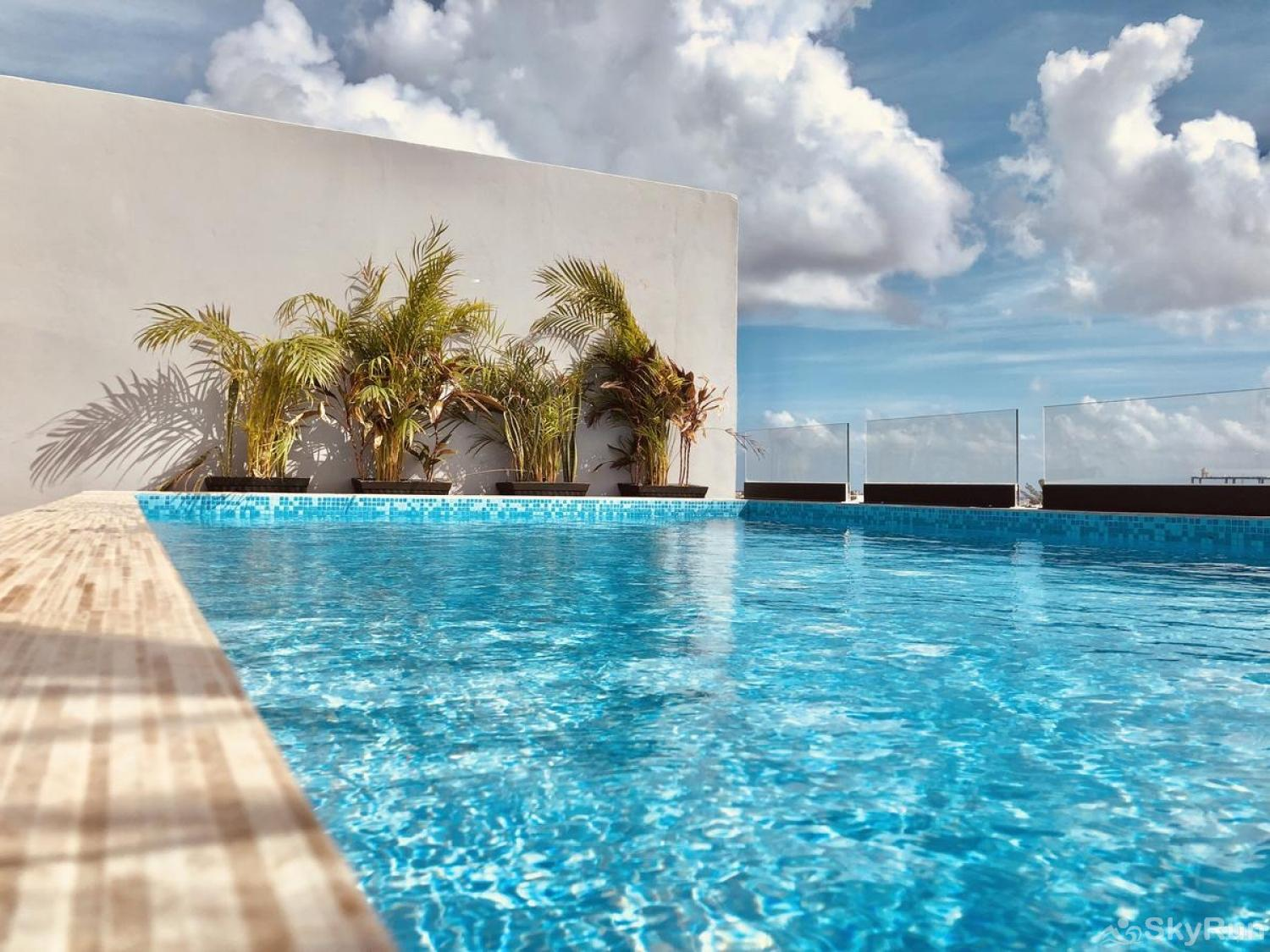 Awesome Condo-Loft style home in the heart of Playa del Carmen 303 SkyRun Luxury Condo Roof Outdoor Pool