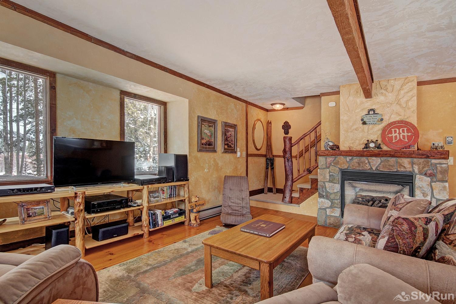 Whispering Pines Living area with ample seating and flat screen TV