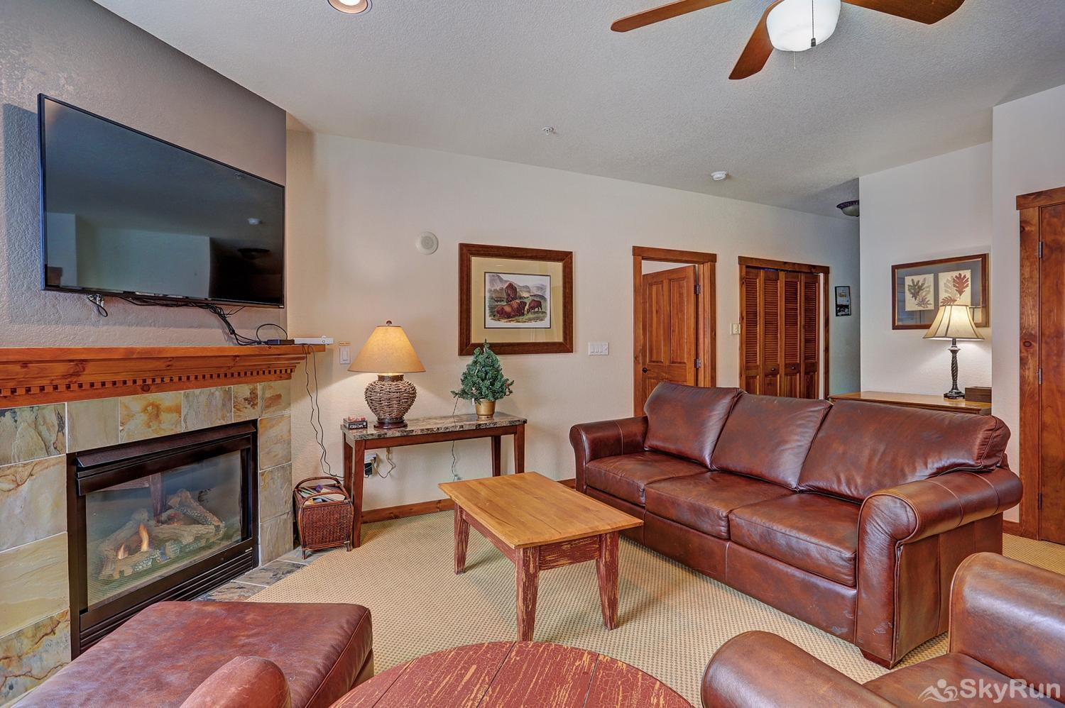 Main Street Station 2203 Cozy living room with gas fireplace and flat screen TV