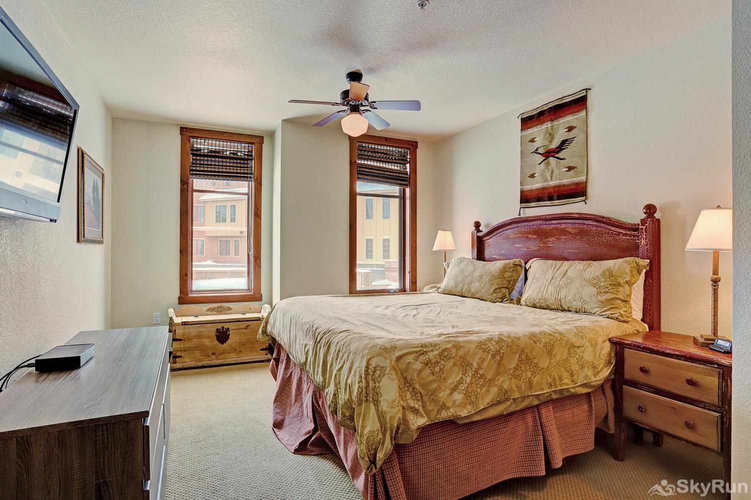 Main Street Station 2203 King master bedroom with flat screen TV, ensuite bath