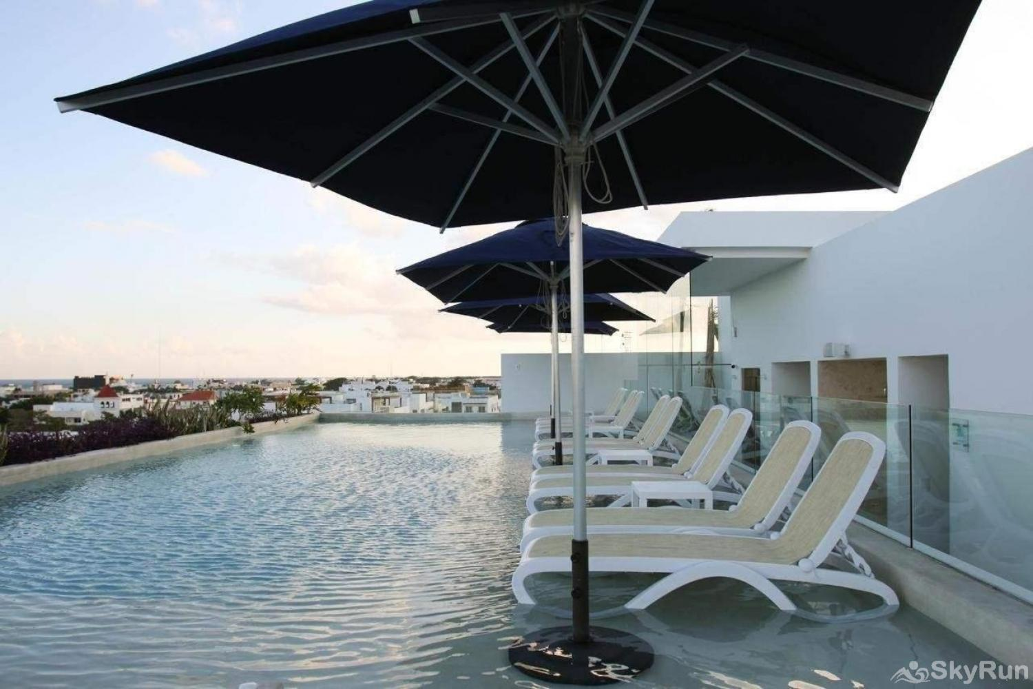 Modern Beach Anah 006D | Playa del Carmen Outdoor Pool with espectacular views from the city Playa del Carmen