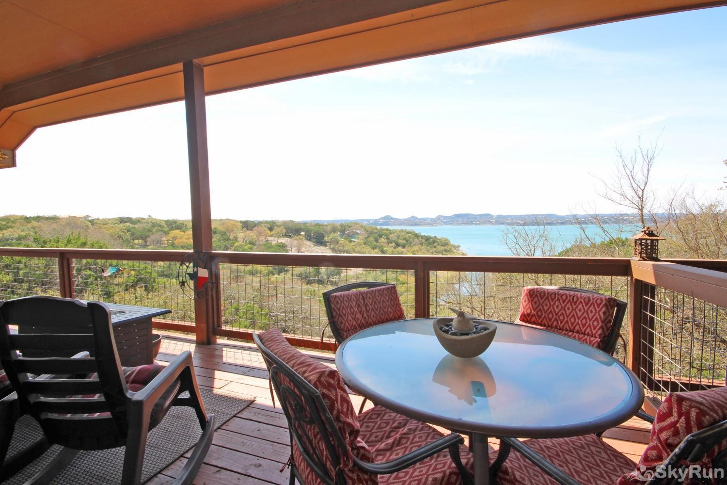 BELLA'S COVE Top deck with sweeping views and comfortable seating