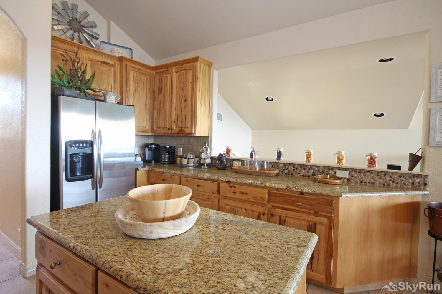 BELLA'S COVE Stainless steel appliances and granite counters in kitchen