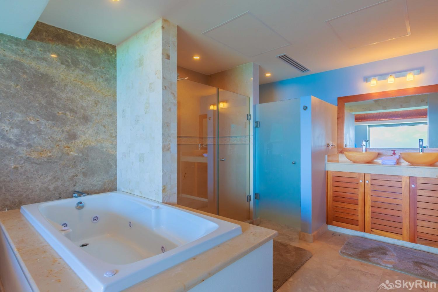 NEW Isla Mujeres Oceanview luxury 3 BR Villa The luxury Master Suite bathroom with big mirrors and a jacuzzi tub
