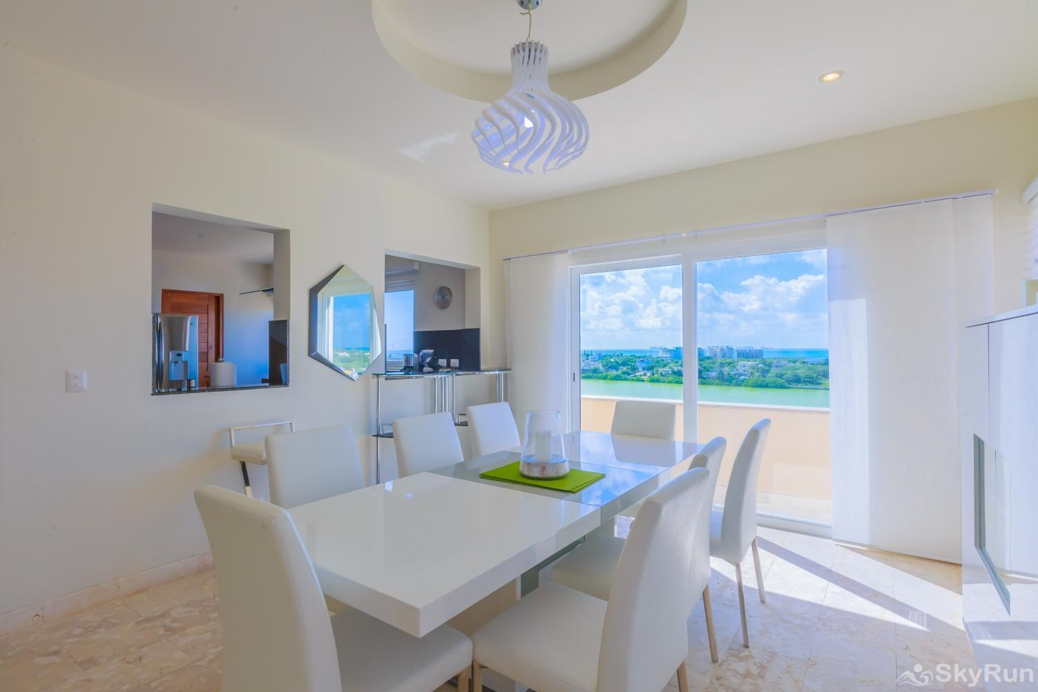 Oceanfront Penthouse | Isla Mujeres | Private Pool | Resort Amenities | Prime location | 3 bedroom | Oceanview Classy and modern dinning room