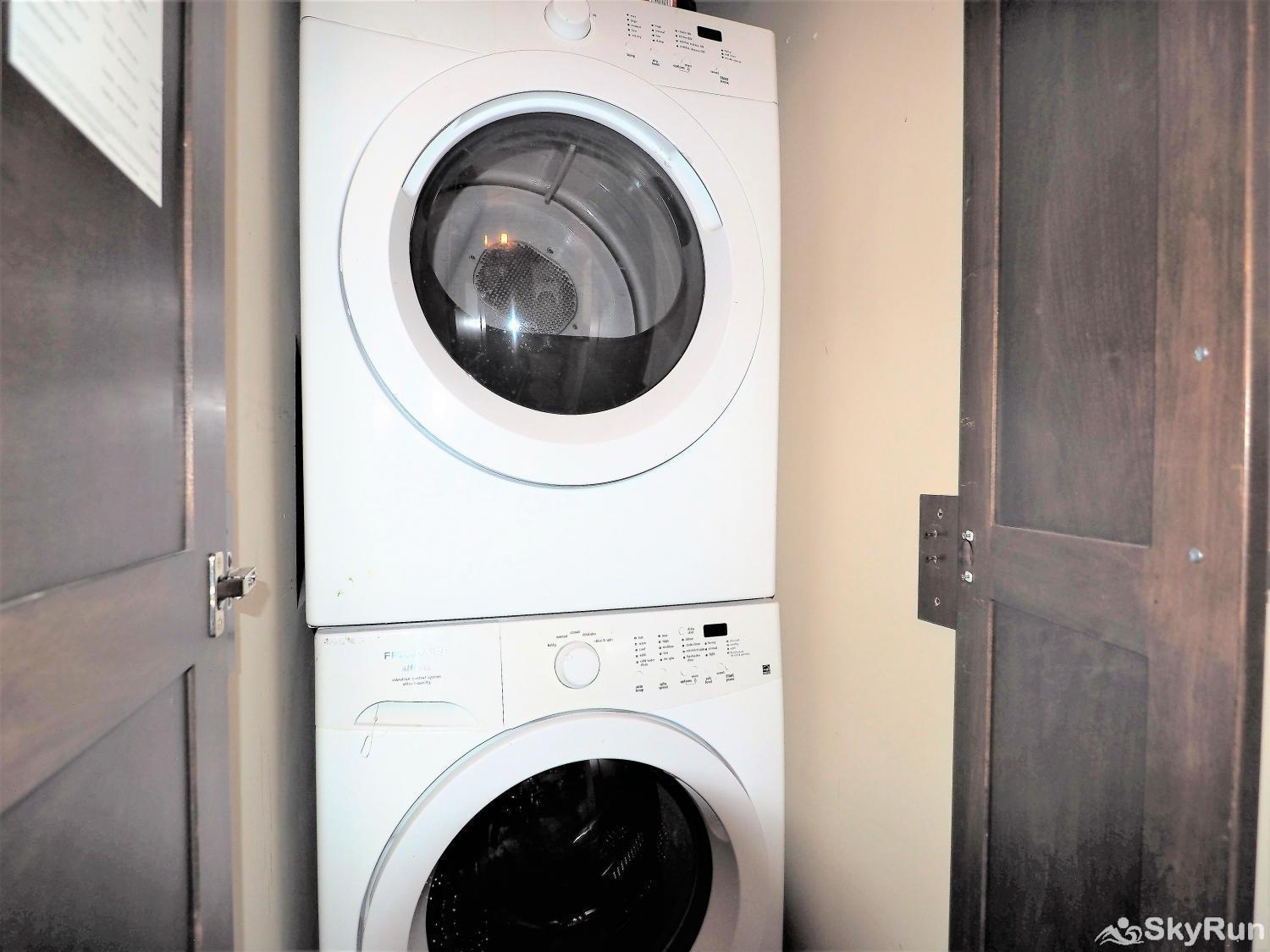 Old Summerland 4 bedroom townhouse The washer/dryer combo is attached to the powder room