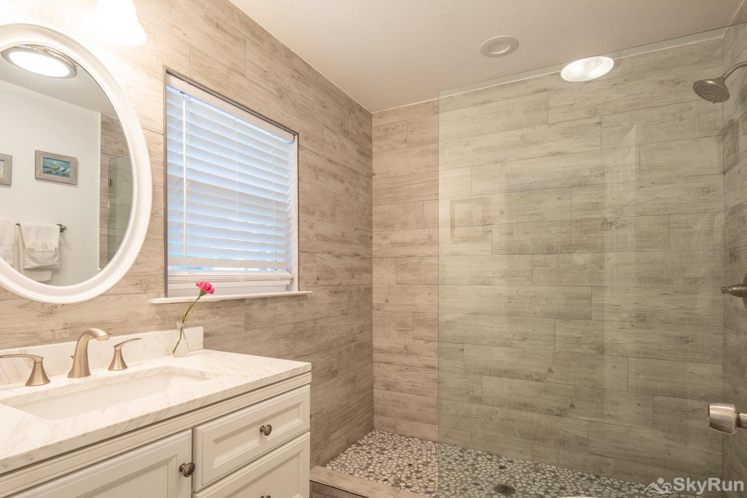 LAKESHORE ESCAPE Second full bathroom with new tiled, walk- in shower