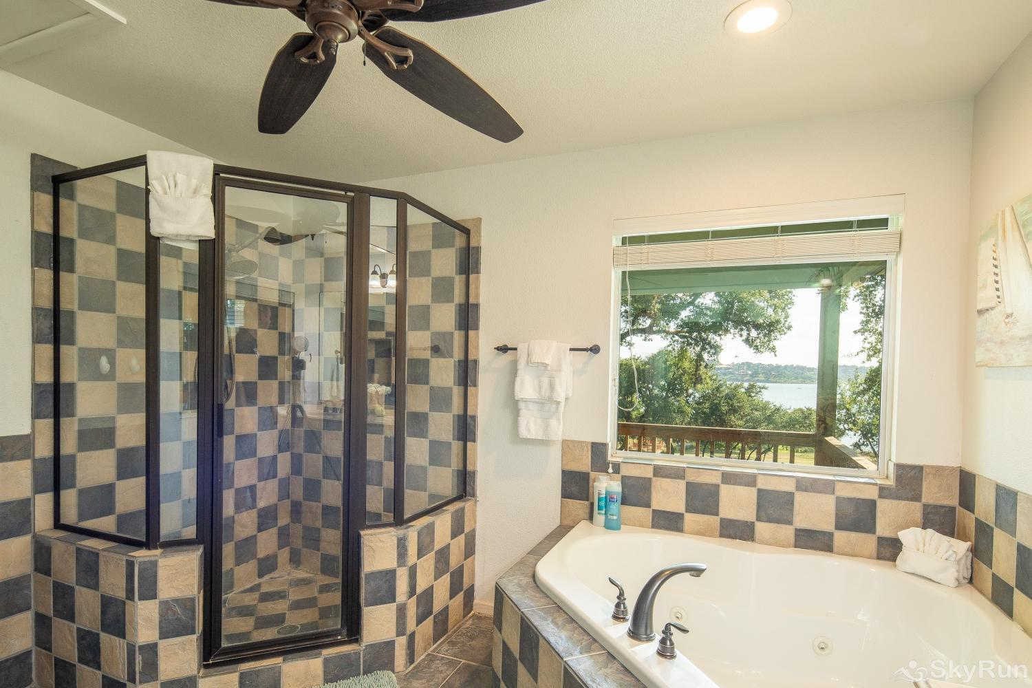 LAKESHORE ESCAPE Master bathroom with walk- in shower and large corner tub