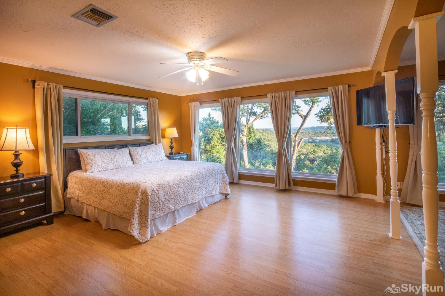 VALLEY VIEW Master bedroom with king bed and TV