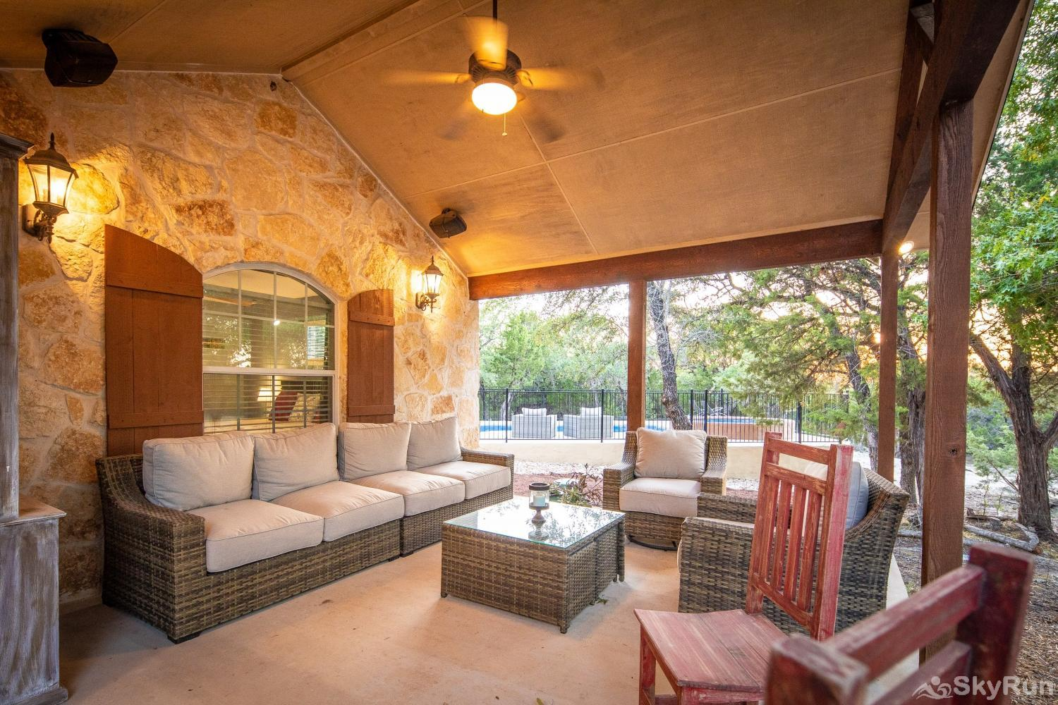 HAYS HIDEOUT Large, covered front porch with outdoor living furniture