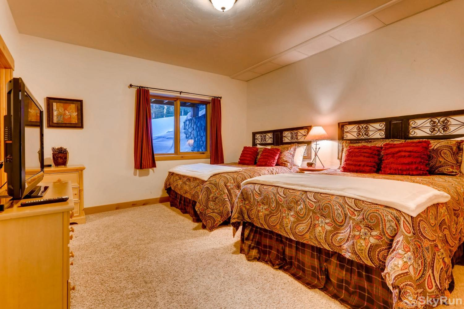 Nangle Woods Retreat Lower level bedroom with 2 queen beds