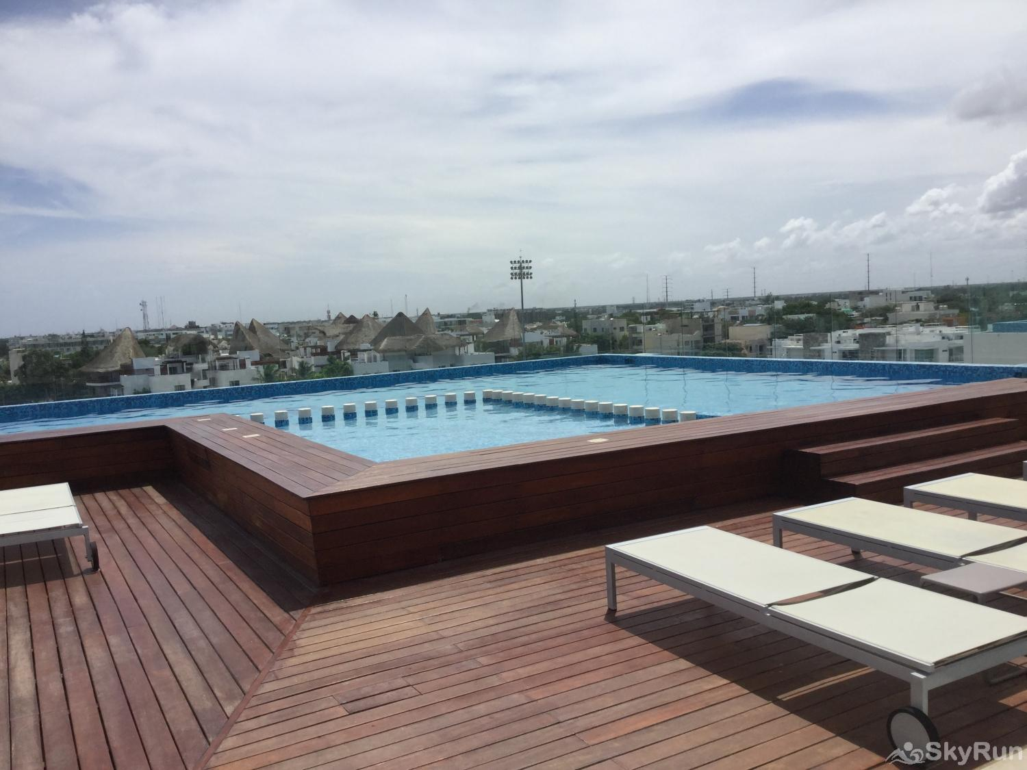 LUXURY RESIDENCE w Panoramic view 1BR 5star hotel amenities Roof top pool area Solea condo Playa Del Carmen