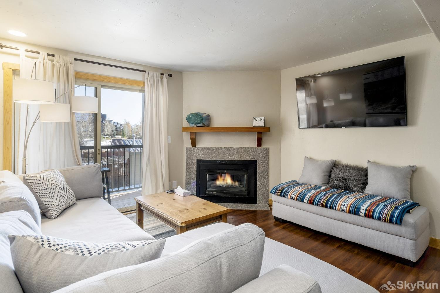 Shadow Run C205 Cozy up by the fire in this beautifully remodeled living room w/ large flat screen.