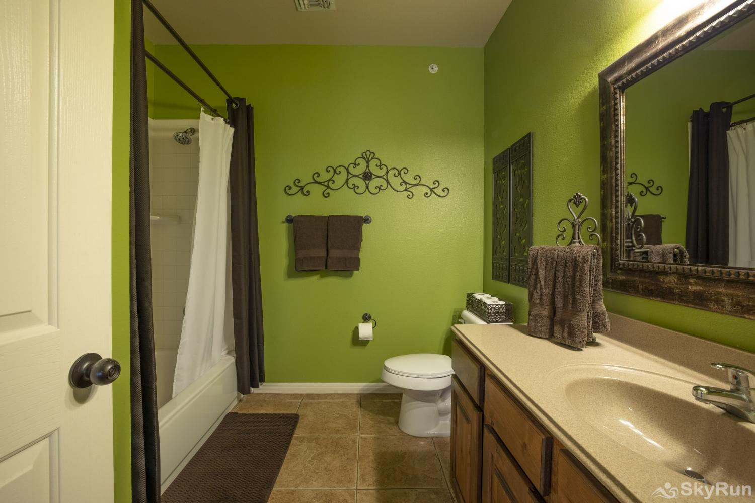 GRUENE GETAWAY Shower/tub combo in second bathroom