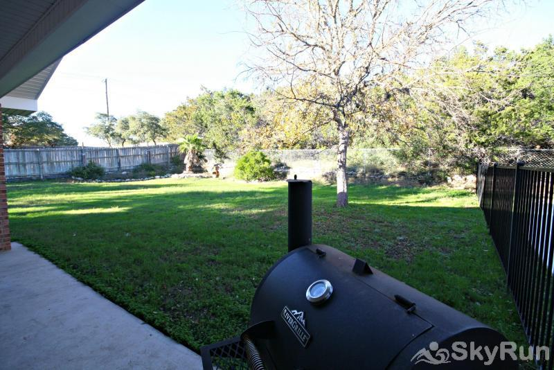 TEXAS LAKE HAUS Fenced Back Yard with Charcoal Grill