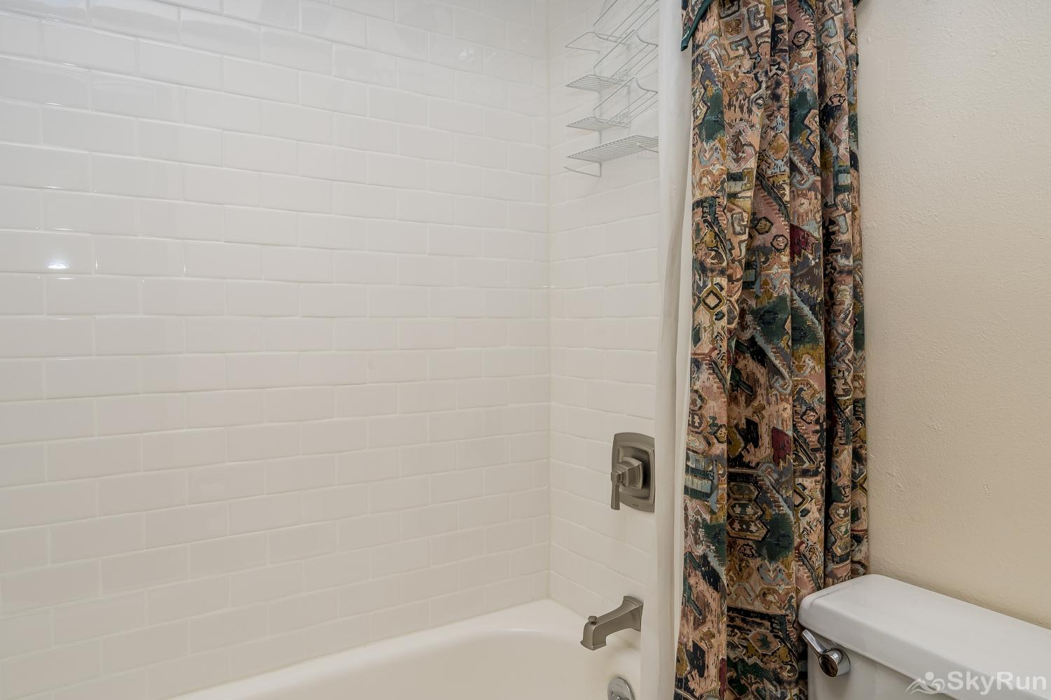 Herbage Townhomes E1 Newly remodeled bathroom with a tub/shower combo
