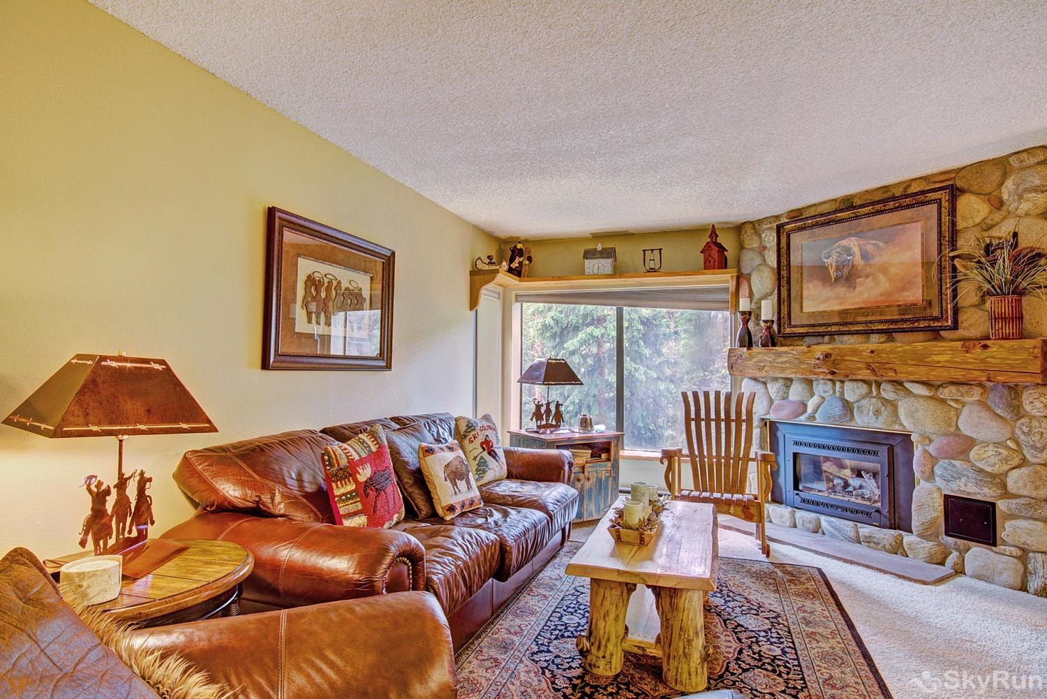 Powderhorn C302 Stay warm by the gas fireplace while enjoying serene forested views